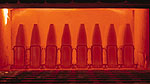Ammunition projectile bodies undergoing the heat treat process at our state-of-the-art facility.
